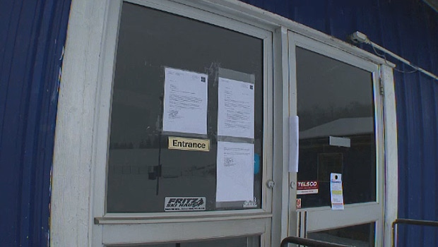 Notices are seen on the doors of the Edmonton Ski Club on Monday, November 13, 2017.