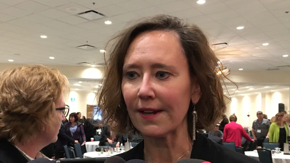 Saskatchewan Education Minister Bronwyn Eyre speaks to reporters after addressing the Saskatchewan School Boards Association annual meeting in Regina, Tuesday, Nov.14, 2017. (THE CANADIAN PRESS/Jennifer Graham)