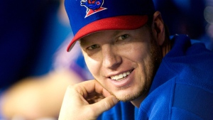 Toronto Blue Jays pitcher Roy Halladay smiles on the bench in Toronto in 2003. THE CANADIAN PRESS/Fred Thornhill