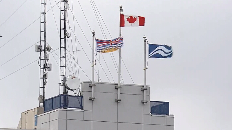 Flags are pictured at the BC Ferries terminal in Tsawwassen, B.C. on Monday, Nov. 14, 2017.