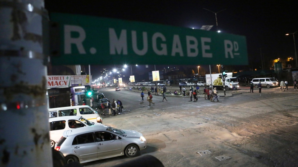 A street scene along Robert Mugabe road in Harare, Tuesday, Nov. 14, 2017. (AP Photo/Tsvangirayi Mukwazhi)