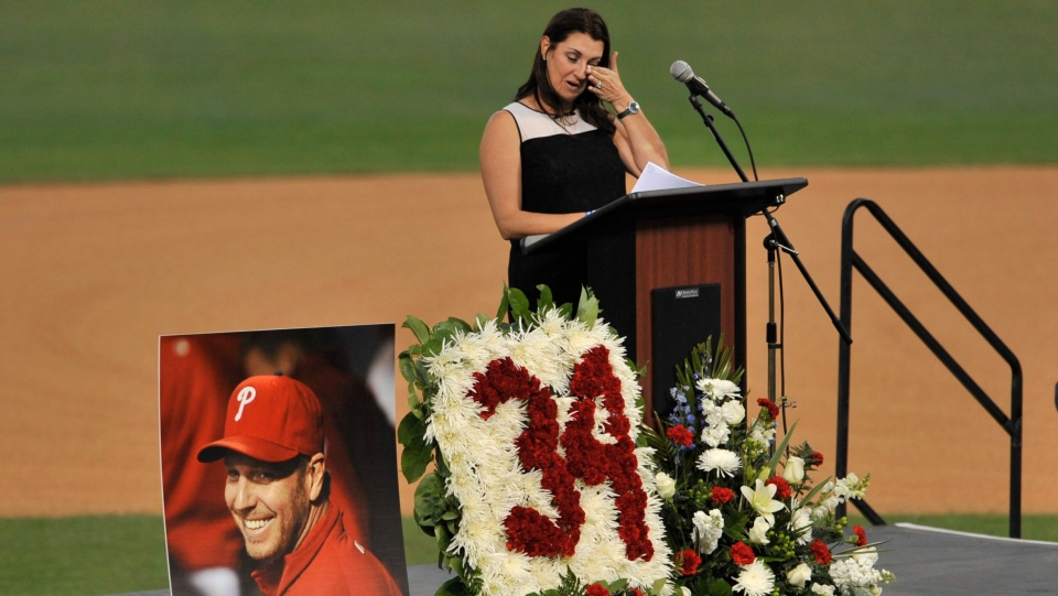 Brandy Halladay, widow of Roy Halladay, talks about her husband during a memorial tribute at the Philadelphia Phillies' spring training stadium, in Clearwater, Fla., on Tuesday, Nov. 14, 2017. (AP Photo/Steve Nesius)