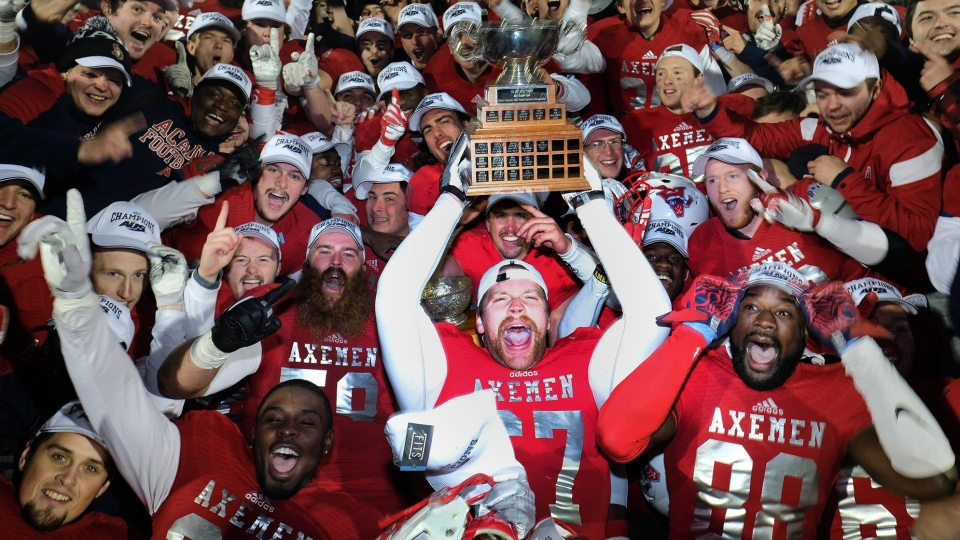 Acadia Axemen football team celebrate their victory over the Saint Mary's Huskies in the Loney Bowl at Acadia University in Wolfville, N.S. on Tuesday, November 14, 2017. (THE CANADIAN PRESS/Ted Pritchard)