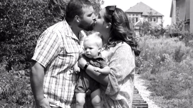 Stuart Ellis is seen in this undated photo with his wife and child. (Facebook)