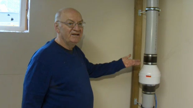 Gordon McIlwain explains how the remediation system in his basement removes radon gas from his home