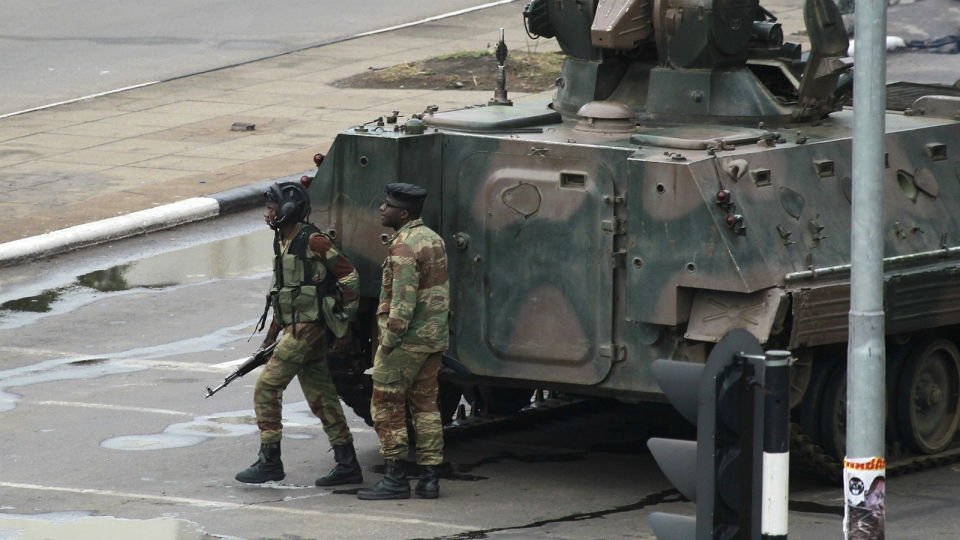 Military vehicle and soldiers on the road leading to President Robert Mugabe's office in Harare, Zimbabwe, on Nov. 15, 2017. (AP / Tsvangirayi Mukwazhi)