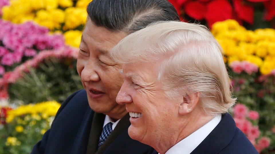 U.S. President Donald Trump, right, chats with Chinese President Xi Jinping during a welcome ceremony at the Great Hall of the People in Beijing, Nov. 9, 2017. (AP / Andy Wong)