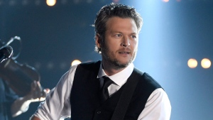 "FILE - In this Nov. 4, 2015 file photo, Blake Shelton performs at the 49th annual CMA Awards in Nashville, Tenn. Shelton was named as People magazine's 2017 ""Sexiest Man Alive."" (Photo by Chris Pizzello/Invision/AP, File)"