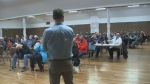 A heated community meeting was held near the Donkin Coal Mine to debate seismic testing plans.
