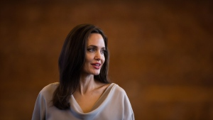 UNHCR Special Envoy Angelina Jolie stands to leave after giving the keynote address to delegates at the 2017 United Nations Peacekeeping Defence Ministerial conference in Vancouver, B.C., on Wednesday November 15, 2017. (Darryl Dyck / THE CANADIAN PRESS)