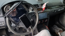 A driver was caught with his cellphone and tablet propped up against his steering wheel Wednesday morning in Vancouver. (Twitter/VPDTrafficUnit)
