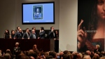 Bidding representatives wait on phones for instructions from bidders for Leonardo da Vinci's 'Salvator Mundi' at Christie's, Wednesday, Nov. 15, 2017, in New York. (AP / Julie Jacobson)