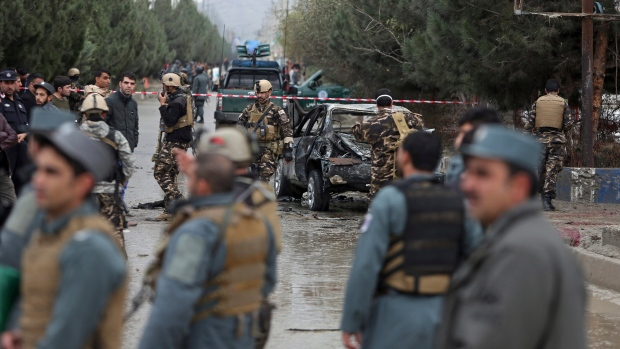 Afghan security personnel arrive to the site of a deadly suicide bombing, in Kabul, Afghanistan, Thursday, Nov. 16, 2017. (AP Photo/Rahmat Gul)