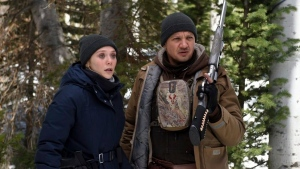 This image released by The Weinstein Company shows Elizabeth Olsen, left, and Jeremy Renner in a scene from 'Wind River.' (Fred Hayes/The Weinstein Company via AP)