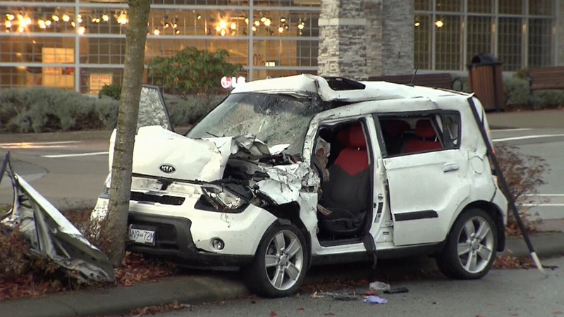 A damaged vehicle is seen at the scene of a serious collision in South Surrey, B.C. on Thursday, Nov. 16, 2017.