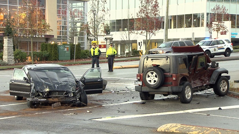 Damaged vehicles are seen at the scene of a serious collision in South Surrey, B.C. on Thursday, Nov. 16, 2017.