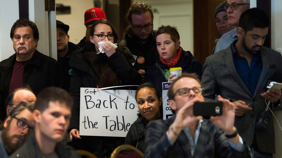 Ontario Public Service Employees Union members representing the negotiations, speak as college teachers listen during a press conference in Toronto on Thursday, November 16, 2017. Ontario's striking college faculty voted to reject a contract offer and continue their nearly five-week job action. The 12,000 college professors, instructors, counsellors, and librarians have been off the job since Oct. 15, leaving some 500,000 students out of class. THE CANADIAN PRESS/Nathan Denette
