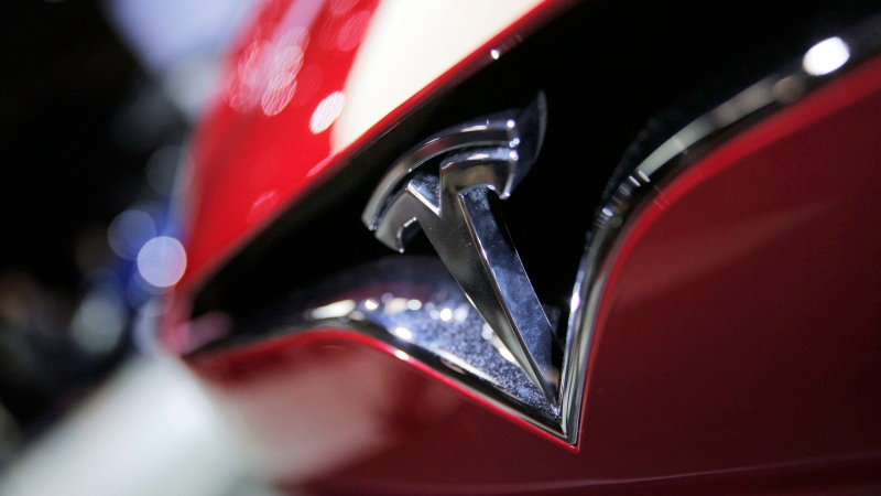 The logo of the Tesla Model S on display at the Paris Auto Show in Paris on Friday, Sept. 30, 2016. (AP Photo/Christophe Ena)