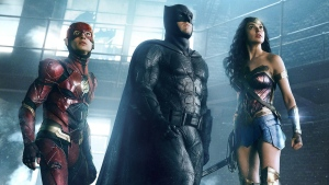 Ezra Miller, from left, Ben Affleck and Gal Gadot in a scene from 'Justice League.' (Warner Bros. Entertainment Inc. via AP)