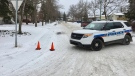 A police vehicle blocks off traffic as officers respond to a report of a man with a gun at a home in Regina on Thursday, Nov. 16, 2017. (GARETH DILLISTONE/CTV REGINA)