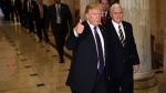 U.S. President Donald Trump gives a thumbs up as he walks with Vice President Mike Pence as he departs Capitol Hill in Washington, Thursday, Nov. 16, 2017. (AP Photo / Susan Walsh)