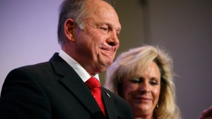 Former Alabama Chief Justice and U.S. Senate candidate Roy Moore speaks at a news conference, Thursday, Nov. 16, 2017, in Birmingham, Ala., with his wife Kayla Moore, right. (AP / Brynn Anderson)