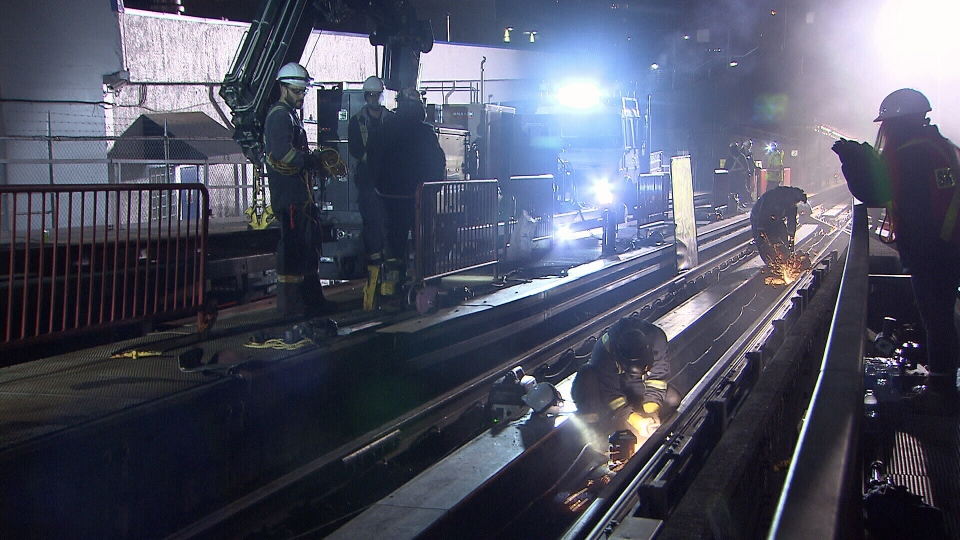 Maintenance crews perform work late at night on Metro Vancouver's SkyTrain system.