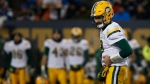 Edmonton Eskimos quarterback Mike Reilly (13) holds his side after getting hit by Winnipeg Blue Bombers' Tristan Okpalaugo (54) during second half CFL western semifinal action in Winnipeg on Sunday, November 12, 2017. THE CANADIAN PRESS/John Woods