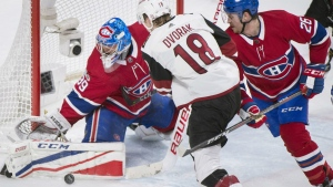Montreal Canadiens goaltender Charlie Lindgren makes a save against Arizona Coyotes' Christian Dvorak as Canadiens' Jeff Petry defends during second period NHL hockey action in Montreal on Thursday, Nov., 16, 2017. (Graham Hughes / THE CANADIAN PRESS)