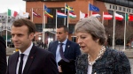 British Prime Minister Theresa May, right, speaks with French President Emmanuel Macron, left, as they walk on a pier at an EU summit in Goteborg, Sweden on Friday, Nov. 17, 2017. (Virginia Mayo/THE ASSOCIATED PRESS)