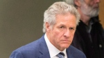 Former construction magnate Tony Accurso walks to the courtroom at his trial in Laval, Quebec on Monday, November 13, 2017. (Ryan Remiorz/The Canadian Press)