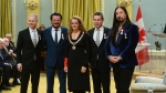 Julie Payette, Governor General of Canada, presents the insignia of the Order of Canada to members of the Tragically Hip Johnny Fay, left to right, Paul Langlois, Gord Sinclair and Rob Baker, at Rideau Hall in Ottawa on Friday Nov. 17, 2017. (Sean Kilpatrick / THE CANADIAN PRESS)