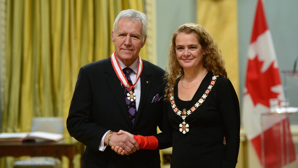 Julie Payette, Governor General of Canada, presents the insignia of the Order of Canada to Alex Trebek at Rideau Hall in Ottawa on Friday Nov. 17, 2017. (Sean Kilpatrick / THE CANADIAN PRESS)