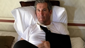 In this picture released by the Government of Manitoba, Premier Brian Pallister is seen convalescing after injuries suffered while hiking in New Mexico. (handout)