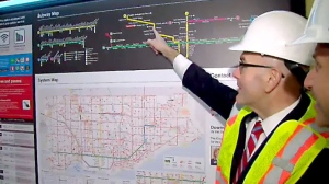 TTC CEO Andy Byford points to a newly amended subway map showing the Toronto-York Spadina subway extension.