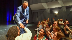 Rev. Jesse Jackson greets visitors after chatting with Chancellor's Professor Michele Godwin and Rabbi Hillel Cohn during the UCI Chancellor's Distinguished Speaker Series at Irvine Barclay Theatre in Irvine, Calif., on Friday, Sept. 8, 2017. (Jeff Gritchen/The Orange County Register via AP)