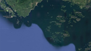 The Broken Group Islands, southeast of Ucluelet, are shown in a Google Maps satellite image.