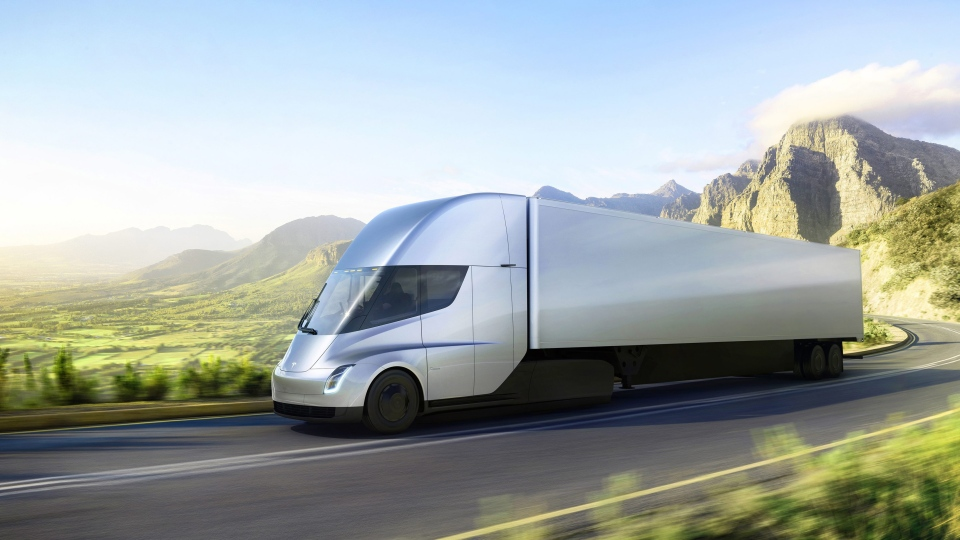 This photo provided by Tesla shows the new electric semitractor-trailer unveiled on Thursday, Nov. 16, 2017. (Tesla via AP)
