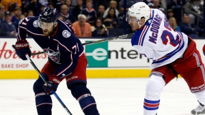Columbus Blue Jackets forward Nick Foligno, left, tries to shoot the puck against New York Rangers defenseman Ryan McDonagh during the second period of an NHL hockey game in Columbus, Ohio, Friday, Oct. 13, 2017. McDonagh was called for slashing on the play. (Paul Vernon/AP Photo)