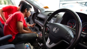 In this Sunday, Nov. 20, 2016, file photo, a Honda technician works on an airbag during a free airbag replacement event in Kuala Lumpur, Malaysia. (AP Photo/Lim Huey Teng, File)