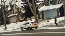 The suspect in an attempted truck theft on Friday in Woodbine is seen running back to the getaway vehicle