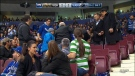 Fans react after an elderly woman was struck in the head by a puck at a Vancouver Canucks game. Nov. 16, 2017.