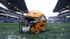 A helmet belonging to a Edmonton Eskimos player is seen on the field during a team practice session in Winnipeg on Wednesday, Nov. 25, 2015. (THE CANADIAN PRESS / John Woods)