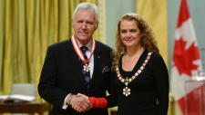 Julie Payette, Governor General of Canada, presents the insignia of the Order of Canada to Alex Trebek at Rideau Hall in Ottawa on Friday Nov. 17, 2017. THE CANADIAN PRESS/Sean Kilpatrick