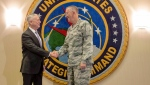 Secretary of Defense Jim Mattis, left, poses for a handshake at Offutt Air Force Base with Gen. John E. Hyten, the head of Strategic Command, in Bellevue, Neb., on September 14, 2017. THE CANADIAN PRESS/AP, Nati Harnik