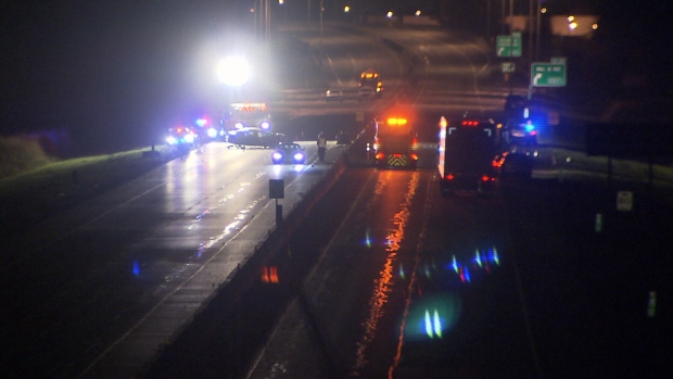 Emergency crews at the scene of a crash where a car flipped after striking a piece of the concrete barrier that had been pushed into the eastbound lanes by a westbound pickpup truck.