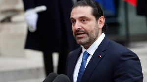 Lebanon's Prime Minister Saad Hariri, speaks to reporters after a lunch with French President Emmanuel Macron at the Elysee Palace in Paris, Saturday, Nov. 18, 2017. Hariri arrived in France on Saturday from Saudi Arabia and may be back in Beirut next week, seeking to dispel fears that he had been held against his will and forced to resign by Saudi authorities.(AP Photo/Christophe Ena)