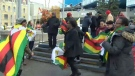 Members of Calgary's Zimbabwean community gathered outside City Hall on Saturday to celebrate the end of the Mugabe regime in their homeland