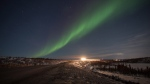 Northern Lights are seen over the Inuvik Tuktoyaktuk highway in Inuvik, NT in this undated handout photo. (THE CANADIAN PRESS / HO-GNWT- James MacKenzie)