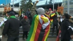 Zimbabwean community celebrates outside city hall